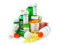 Prescription and Non-Prescription Medications. Assorted prescription and non-prescription medications in green and orange bottles. Photo includes a bronchial Royalty Free Stock Photography