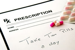 Prescription pad and pills stock photos