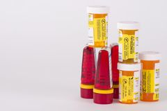 Prescription Pill Botles. Seven multi-colored prescription pill bottles stacked on white background royalty free stock images