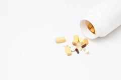 Prescription pill bottle spilling pills Stock Photo