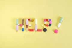 Prescription Pills and Medicine Medication Drugs spelling Help. Generic prescription medicine drugs pills and assorted pharmaceutical drugs tablets with gel caps royalty free stock photo