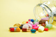 Prescription Pills and Medicine Medication Drugs spilling out of a bottle Royalty Free Stock Photos