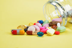 Prescription Pills and Medicine Medication Drugs spilling out of a bottle Stock Photography