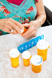Prescription Pills for the Week. Senior woman sorting her pills for the week Stock Image