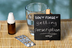 Prescription reminder on glass table Stock Photography