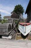 Prese dell'aragosta e barca di riga Immagine Stock