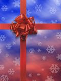 Present 1 no tag. Red ribbon over red and blue paper with snow flakes icons Stock Image