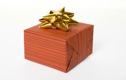 Present. One red gift with a bow isolated on a white background Royalty Free Stock Images
