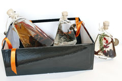 Present. Gift-box with decorative bottles of aromatic oil Stock Image