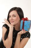 Present. The pretty girl is glad to have some present Royalty Free Stock Images