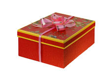 Present. Gift box with a pink ribbon, isolated on a white background royalty free stock image