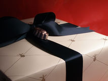 Present. Sectional shot of wrapped present on red background Stock Images