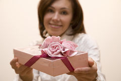 Present 2. Young woman make a present Stock Image
