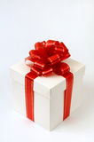 Present 2. White fancy box with red ribbon christmas present on white Stock Image