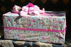 Present. Large baby shower gify wrapped in colorful paper Stock Photo