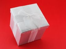 Present. Christmas present on a red background Stock Images