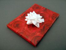 Present. Box and bow on grey Royalty Free Stock Image