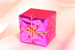 Present. Small box of present in a smooth background Royalty Free Stock Images