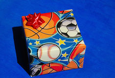 Present wrapped in sports paper Royalty Free Stock Photo
