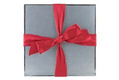 Present. Silver gift box with red bow isolated on white Stock Photography