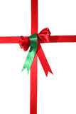 Present. Red satin ribbon bow folded like a present  on withe isolated background Stock Photo