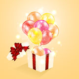 Present with balloons Royalty Free Stock Photo