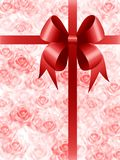 Present with bow. Present with red bow packed in decorative paper with roses Royalty Free Stock Photography