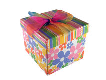 Present box. Isolated colorful present box with rainbow bow Stock Photography