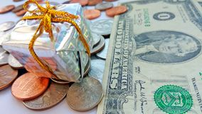 Present box with American coins with dollar usa background stock images
