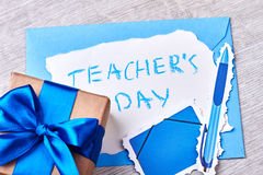 Present box with blue bow. Stock Image