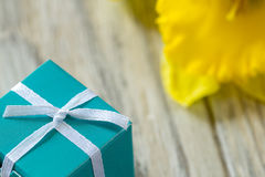 Present-box and blurred yellow flower on background Stock Photo