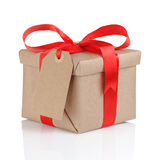 Present box from brown papaer with red ribbon bow Stock Photos