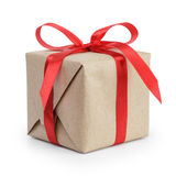 Present box from brown papaer with red ribbon bow Royalty Free Stock Image