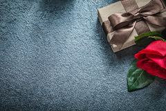 Present box with brown ribbon red rose on black background holid Royalty Free Stock Photos