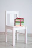 Present box on chair Royalty Free Stock Images