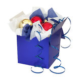 Present Box with Christmas Toys. Present box with wraping paper and xmas toys isolated on white royalty free stock photo