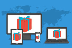 Present box on device monitors Royalty Free Stock Images