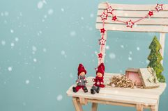 Present box and figurines. Christmas holiday celebration concept Stock Photo