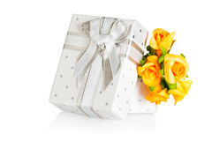Present box and flower boutonniere Stock Photos