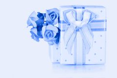 Present box and flower boutonniere Royalty Free Stock Photos
