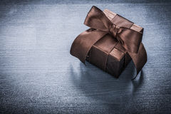 Present box glittery paper on vintage wooden board holiday conce Royalty Free Stock Photography