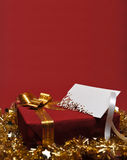 Present box with greeting card Royalty Free Stock Photo