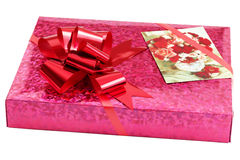 Present Box with Greeting Card. Present box with red bow and greeting card isolated on white Royalty Free Stock Images