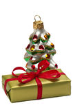 Present box and a Happy New Year tree decoration Royalty Free Stock Image