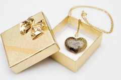Present box with heart pendant Stock Photos
