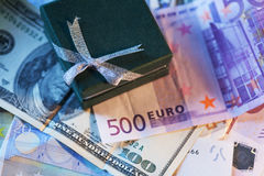 Present box and money - dollar and euro Royalty Free Stock Image
