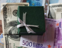 Present box and money - dollar and euro Royalty Free Stock Photography