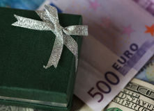 Present box and money - dollar and euro Royalty Free Stock Photo