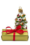 Present box and a New Year tree decoration Stock Photography