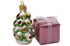 Present box and a New Year tree decoration Royalty Free Stock Photos